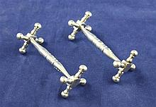 A pair of William IV silver knife rests, 2.75in.