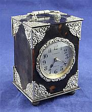 A late 19th/early 20th century silver mounted tortoiseshell carriage clock, 4.75in.