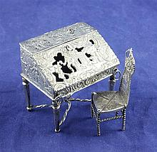 A late 19th/early 20th century Hanau? silver miniature bureau, 2.25in.