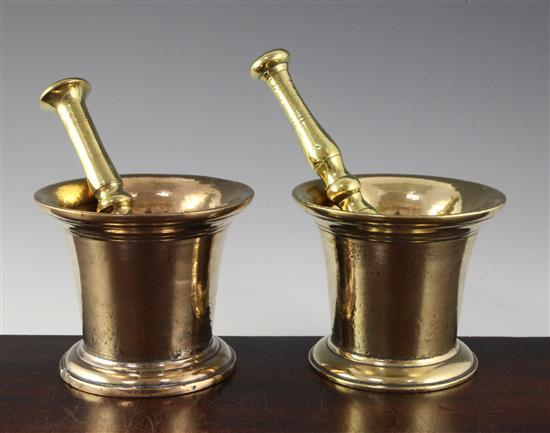 An 18th century bell metal mortar with brass pestle, 5.25in.