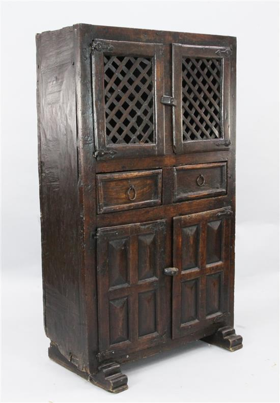 An antique Spanish walnut food cupboard, W.2ft 10in. D.1ft 7in. H.4ft 10in.