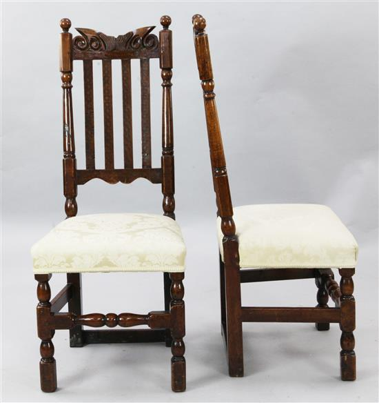 A pair of late 17th century fruitwood dining chairs, W.1ft 6in. H.3ft 7in.