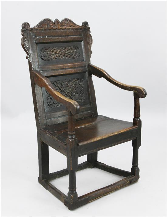 A 17th century oak Wainscot chair, W.1ft 11in. H.3ft 8in.