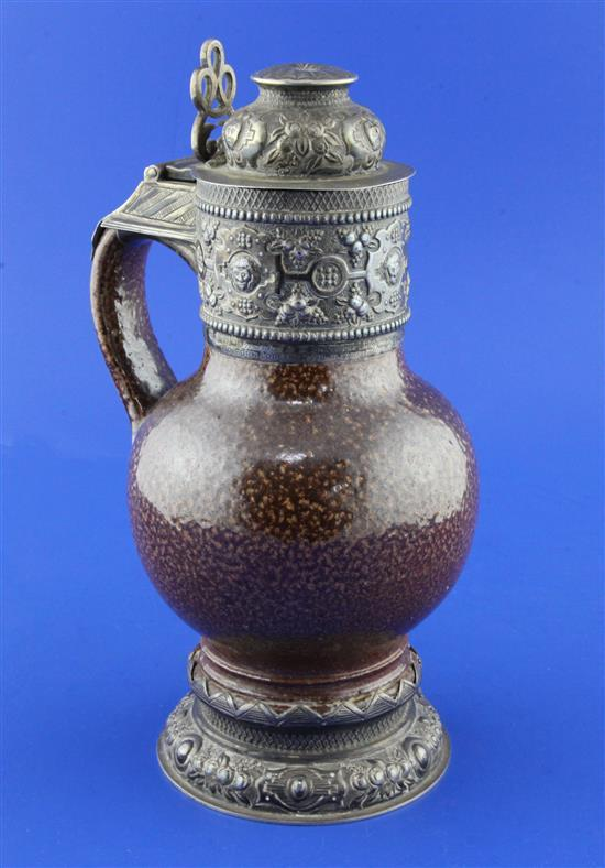 An Elizabethan style ''tiger ware'' jug, George V silver mounts, 9.75in.