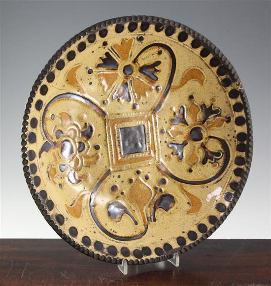 A Staffordshire slipware dish, c.1720-40, in the manner of Samuel Malkin (1668-1741) diameter 36cm (14.1in.)