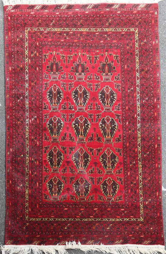 An Afghan carpet, 9ft 4in by 6ft 6in.