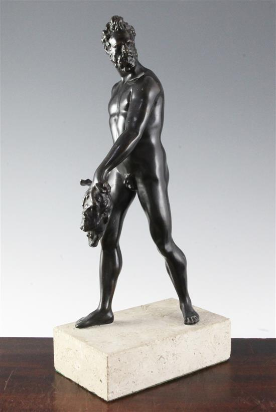 After the antique. A bronze figure of Hercules carrying a sword and a head, 16.5in.
