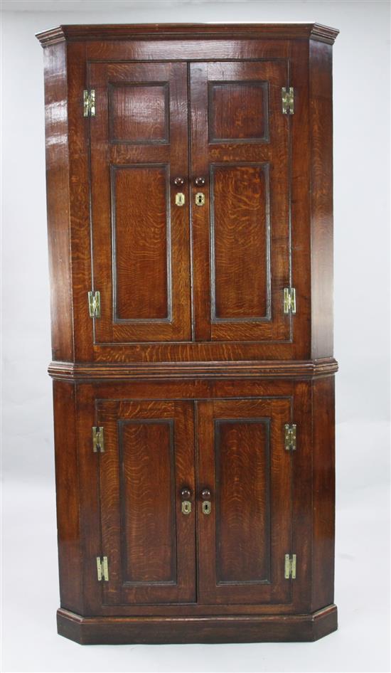 A George III oak corner cupboard, W.3ft 3in. H.6ft 7in.