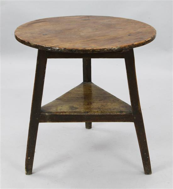 A George III stained pine and fruitwood cricket table, W.2ft 3in. H.2ft 4in.