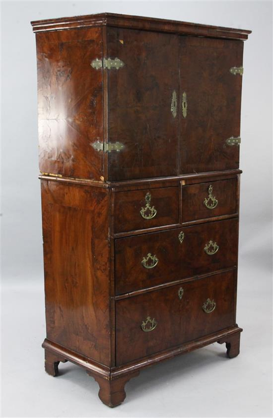 An early 18th century crossbanded cabinet on chest, W.3ft D.1ft 9in. H.5ft 6in.