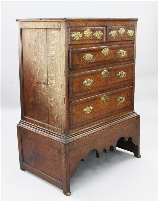 A George II featherbanded oak chest on stand, W.2ft 11in. D.1ft 11in. H.3ft 11in.