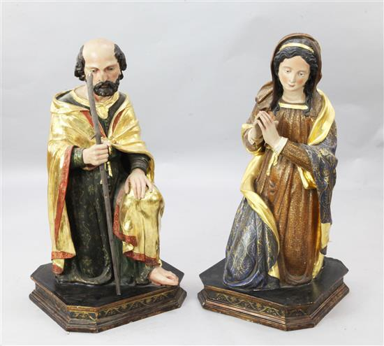 A pair of polychrome painted parcel gilt wooden altar figures of Joseph and Mary, 3ft