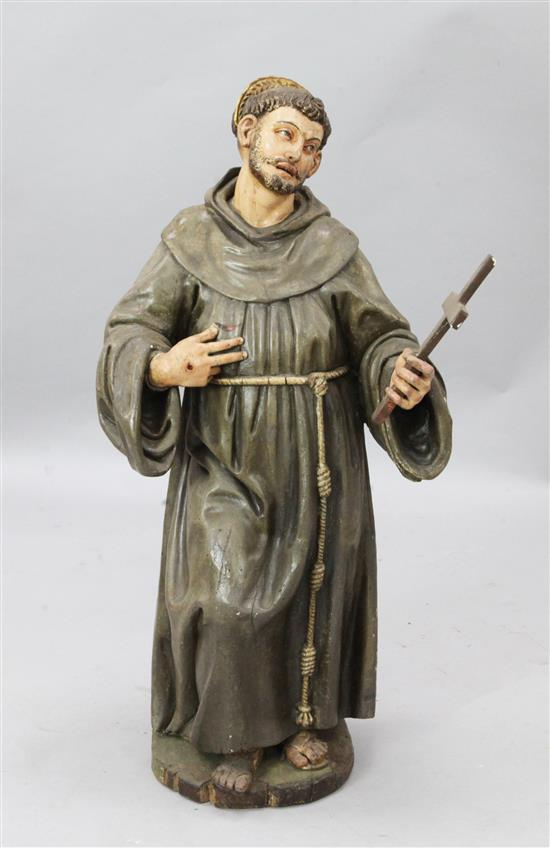 A parcel gilt painted wood altar figure of St Francis, 3ft