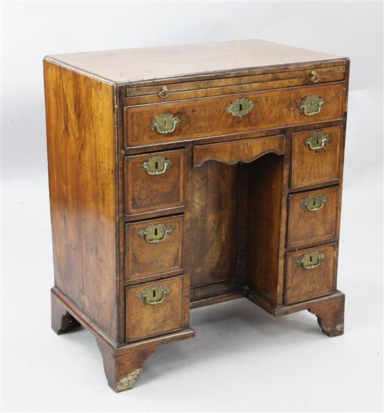 A George I walnut caddy top kneehole desk, W.2ft 4in. D.1ft 6in. H.2ft 7in.