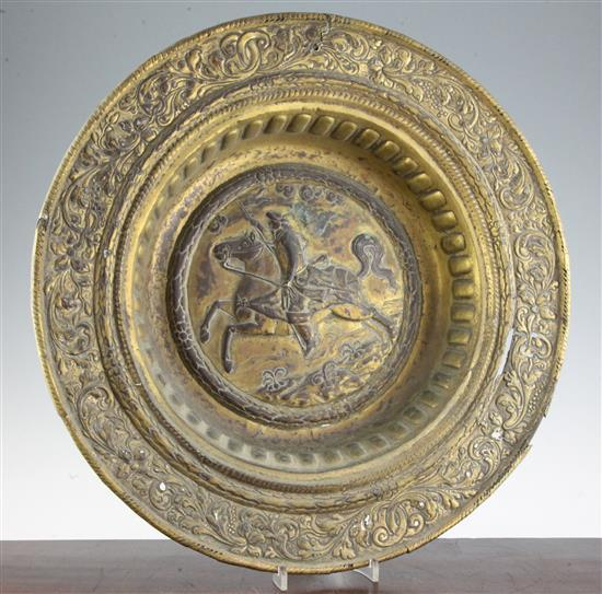 A late 17th century Dutch gilt copper alms dish, 19in.