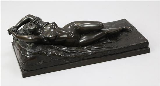 Manner of Claude Michel Clodion. A large bronze of a classical woman reclining upon a cloak and vines, W.2ft 9in. H.10in.