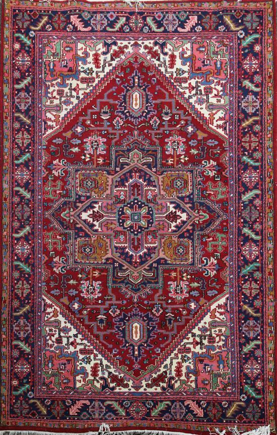 A Heriz carpet, 9ft 6in by 6ft 7in.