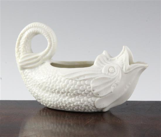 A soft paste porcelain 'dolphin' sauceboat, 18th century, possibly Saint-Cloud or Mennecy, length 14.5cm (5.7in.)