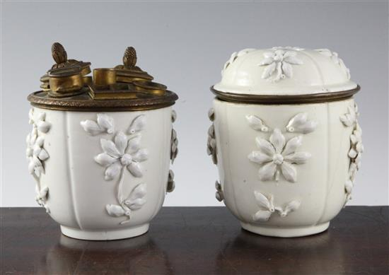 A pair of Saint-Cloud porcelain pots and one cover, mid 18th century height 11.5cm (4.5in.)