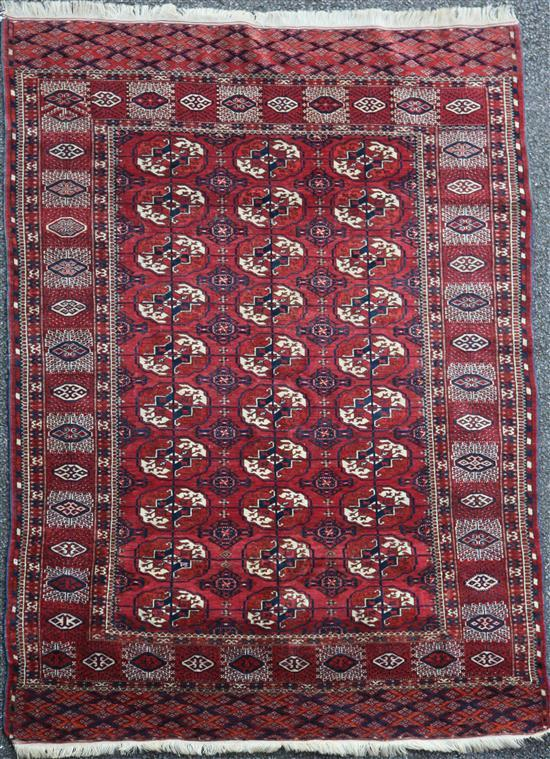 A Bokhara rug, 6ft 1in by 4ft 6in.