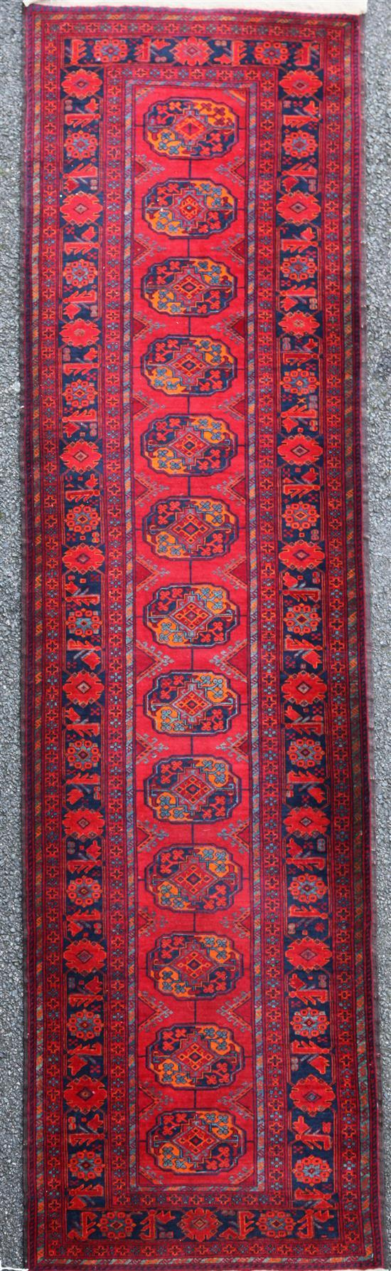 A Bokhara style runner, 9ft 6in by 2ft 9in.