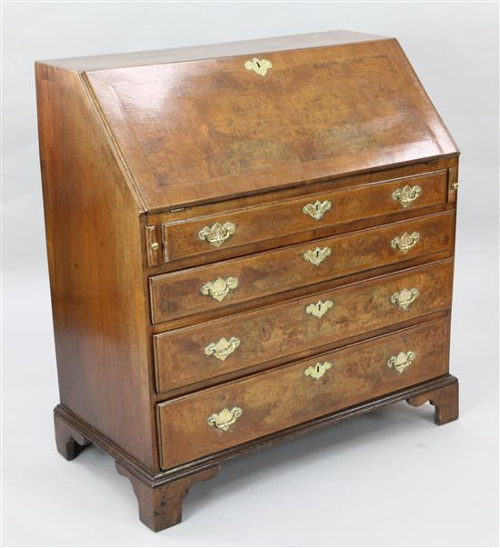 A mid 18th century walnut veneered oak bureau, W.3ft 1in. D.1ft 8in. H.3ft 4in.