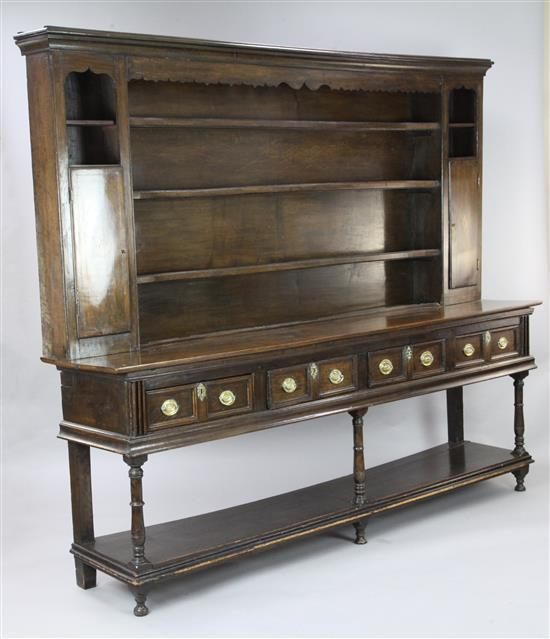 An 18th century oak dresser, W.7ft 9in. D.1ft 7in. H.6ft 6in.