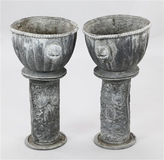 A pair of 17th century style lead garden urns, Diam. 1ft 1in. H.2ft