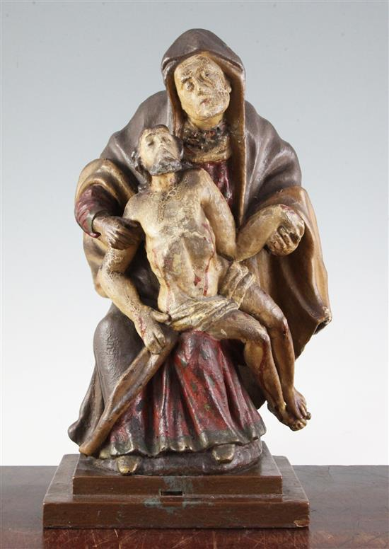A 19th century Continental carved wood group of the Pietà, 15in.