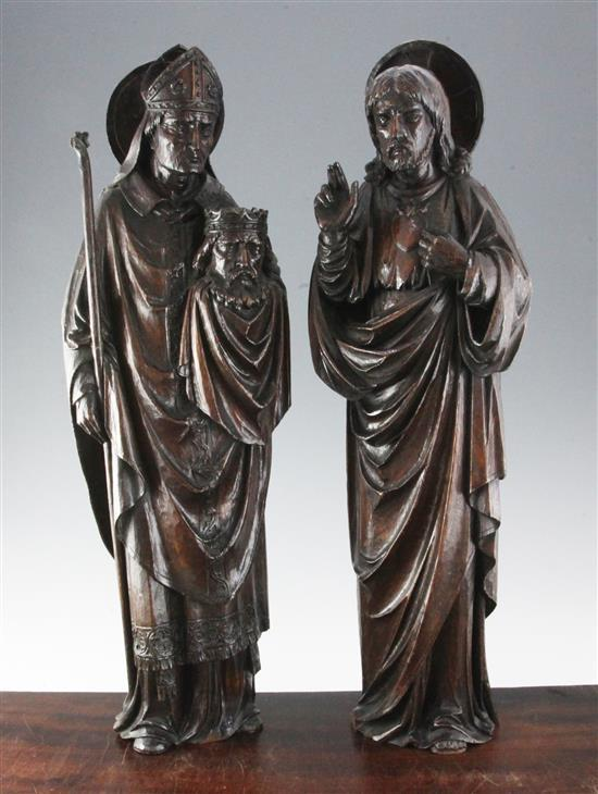 A pair of 19th century Flemish carved oak figures of Christ and a Bishop, 25.5in.