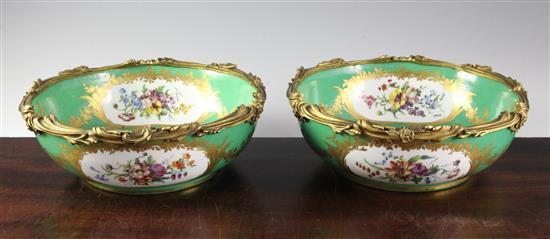 A pair of Sevres porcelain green ground bowls, c.1773, diameter incl. mounts 24cm (9.5in.), some decoration possibly later