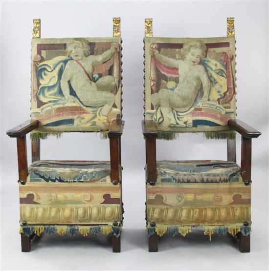 A pair of late 17th century walnut armchairs,