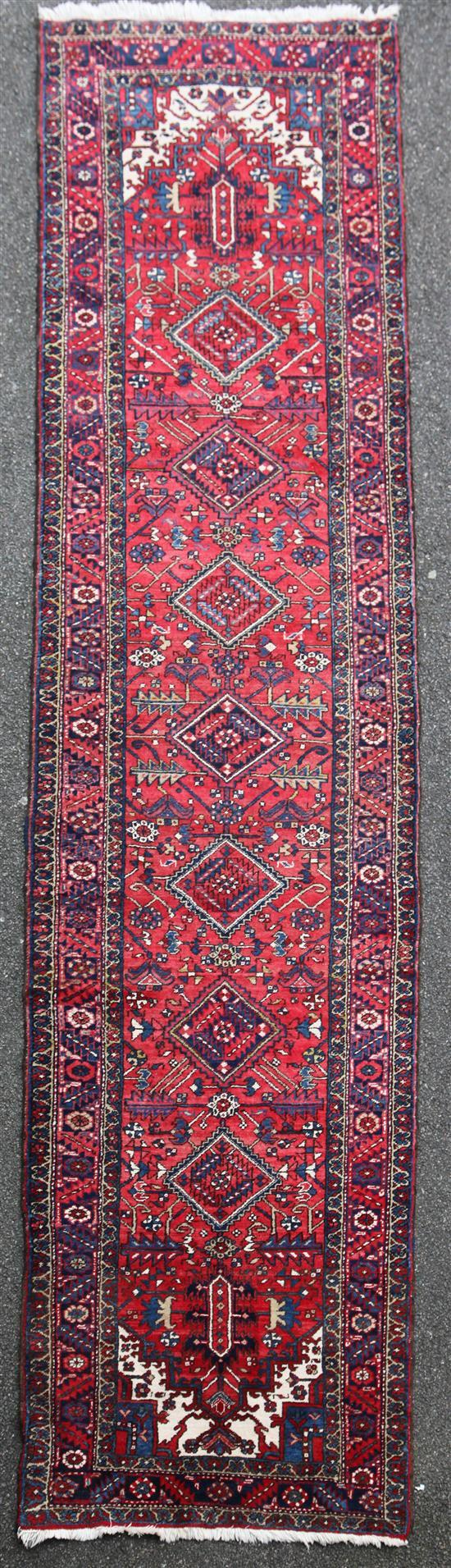 A Persian Heriz runner, 14ft 2in by 3ft 9in.