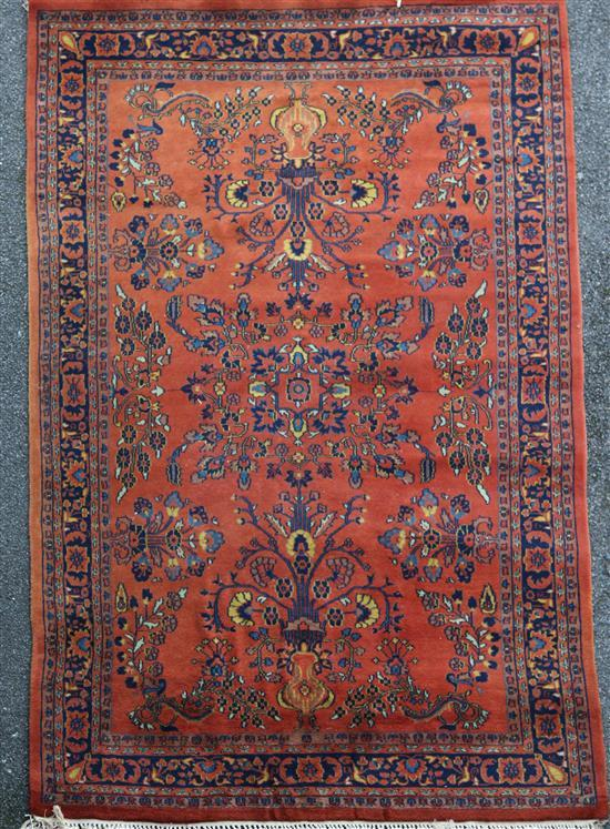 A Persian rug, 9ft by 6ft.