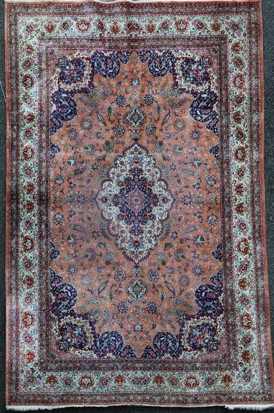 A Persian silk rug, 9ft 8in by 6ft 5in.
