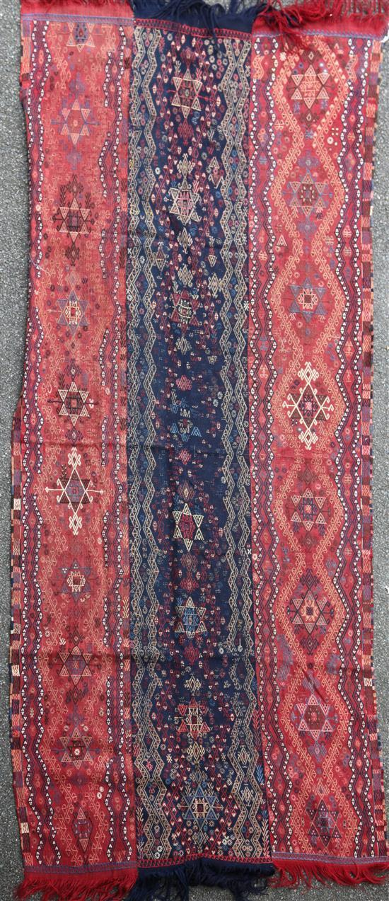 A Kelim wall hanging/rug, 9ft 7in by 4ft 2in.