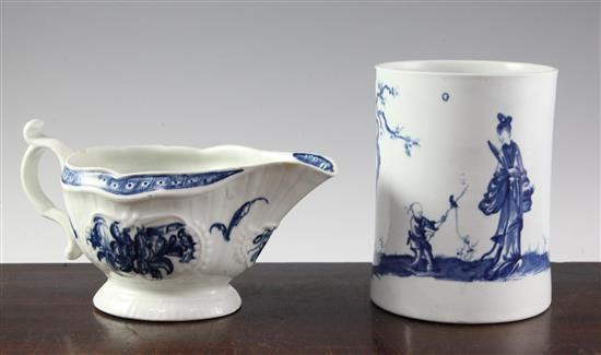 A Worcester blue and white ''a walk in the garden'' pattern mug, c.1758 and a strap flute floral pattern sauceboat, c.1775, height 14cm