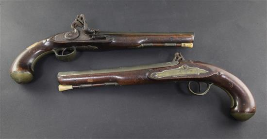 A pair of early 19th century flintlock holster pistols, signed Weston, Lewes, 15in.
