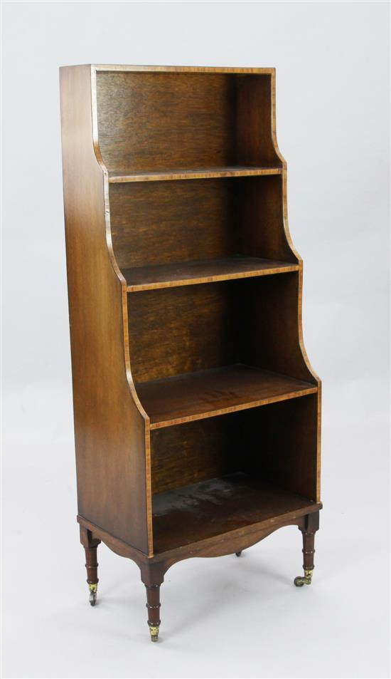 A Sheraton style crossbanded mahogany waterfall bookcase, W.1ft 8in. D.1ft H.4ft 1in.