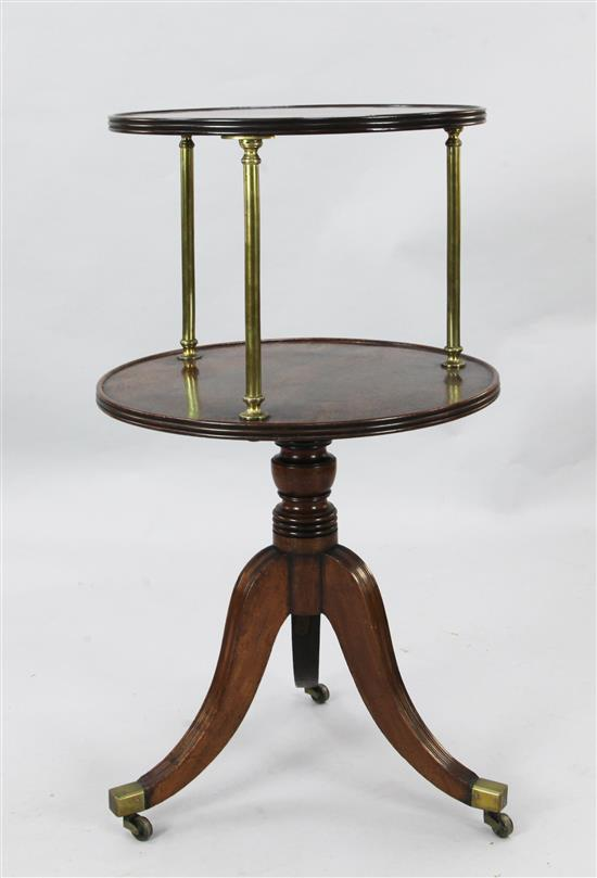 A Regency mahogany revolving two tier whatnot, Diam. 1ft 10in. H.3ft 2in.