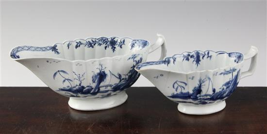 Two Worcester blue and white Fringed Tree pattern fluted sauceboats, c.1758-62, 7in. & 8.25in., the smallest damaged