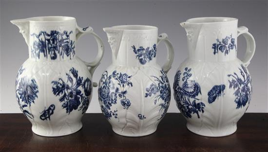Three Worcester blue and white cabbage leaf moulded mask jugs, c.1770-80, 8.5in. - 9.25in., two cracked