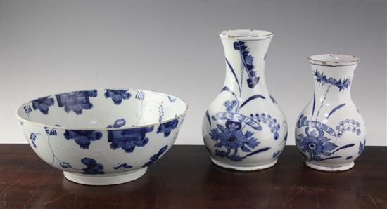 An English delft ware punch bowl and two graduated English delft ware baluster vases, second quarter 18th century,