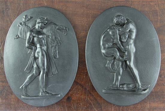 A pair of Wedgwood black basalt oval plaques, late 18th century, 7.3in., one damaged