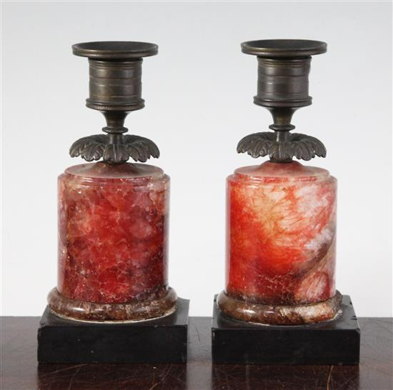 A pair of Regency bronze and red fluorospar / Blue John mounted candlesticks, 6.25in.