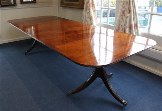 A Regency style mahogany twin pedestal extending dining table, Extended W.10ft D.4ft 1in. H.2ft 4in.