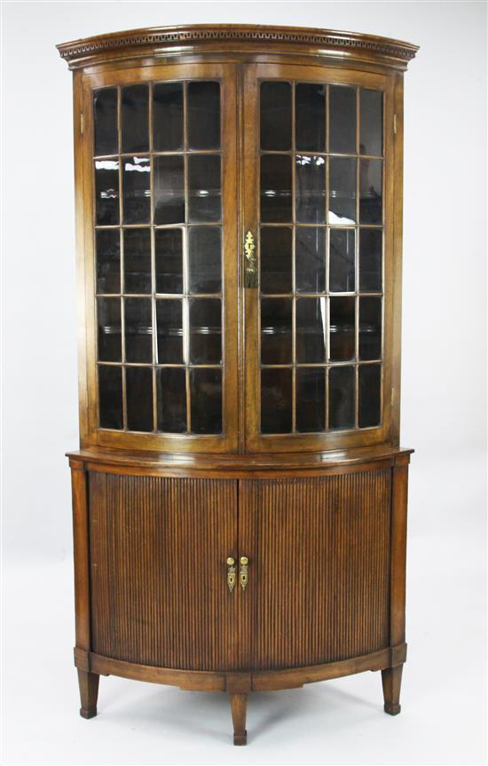 A Regency style mahogany bowfront corner cabinet, W.3ft 3in. H.6ft 4in.