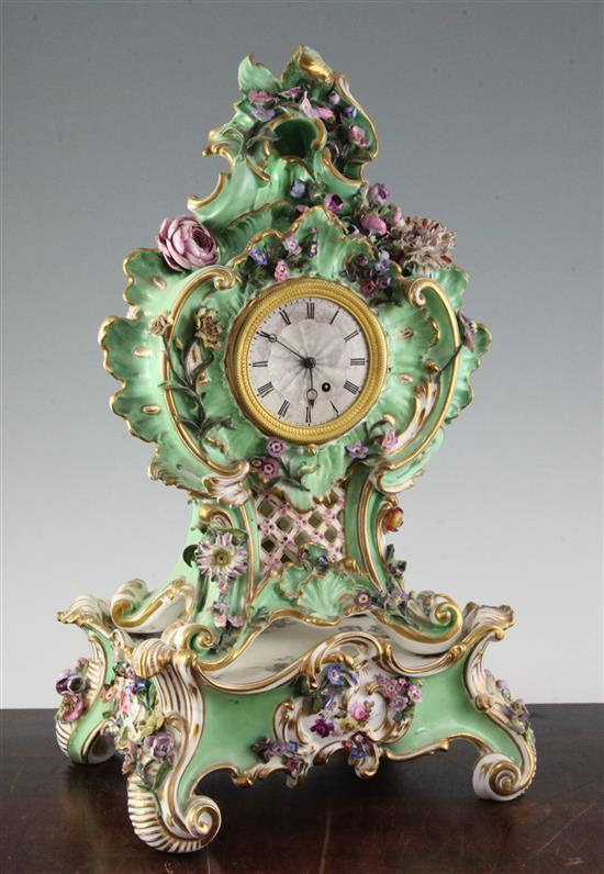 A Coalport floral encrusted mantel clock, with matching plinth, c.1830-5 17in.
