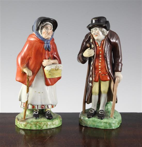A pair of Staffordshire pearlware figures of an elderly lady and gentleman, c.1830, height 18cm (7.1in.), restorations
