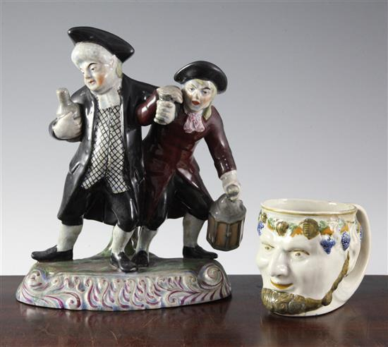A pearlware 'Bacchus' mug and a Staffordshire style nightwatchman group, 23cm & 9cm (9in. & 3.5in.)